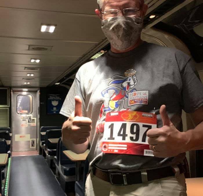 image of 5k runner on train