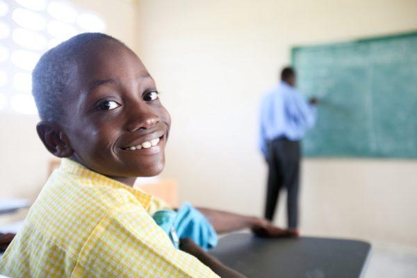 Haitian boy in school